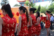 The girls dressed in Chinese dresses holding scissors to cut the ribbons and officially open the arch. Photo: Prelene Singh